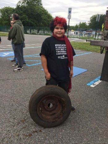 Kid Volunteer with a Tire